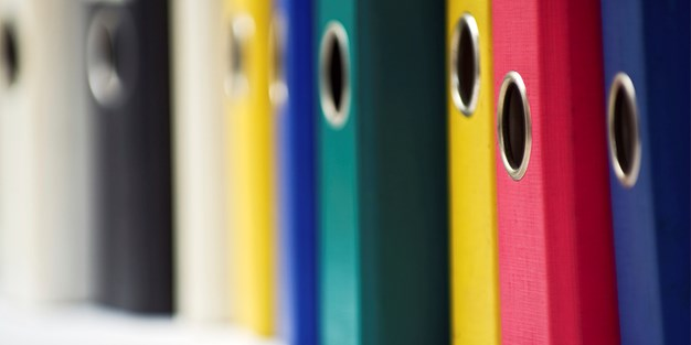 Folders in different colors . Photo