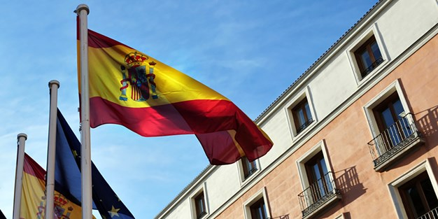 A Spanish flag waving in the wind. Photo