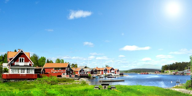 A couple of houses near a lake in Sweden. Photo