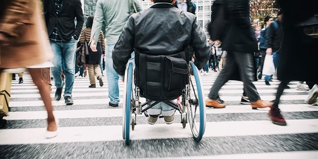 A person using a wheelchair. Photo