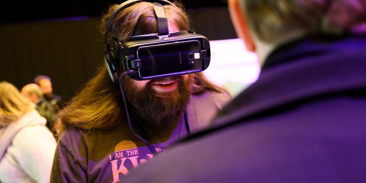 A person testing VR glasses. Photo
