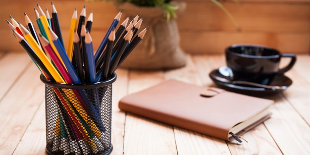 Pens in a pen holder . Photo