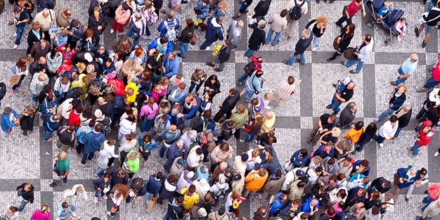 A crowd of people on a square seen from above. Photograph