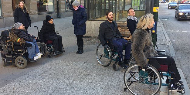 Practical training in wheelchair outside in an urban environment. Photo
