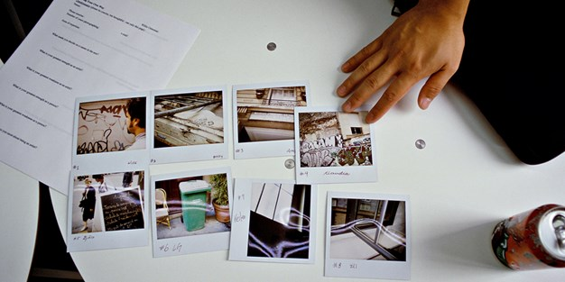 Photos scattered on a table . Photo