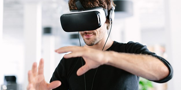 A person using VR-glasses. Photo