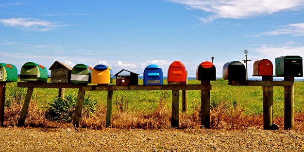 Letterboxes in different shapes and form in the countryside. Photograph