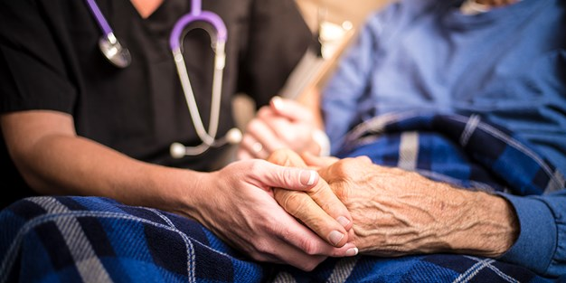 A nurse and an elderly patient. Photo