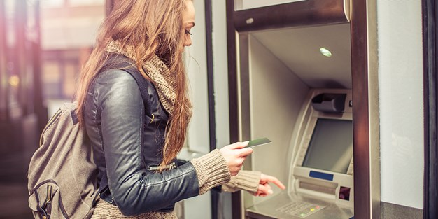 A person using a self-service machine. Photo