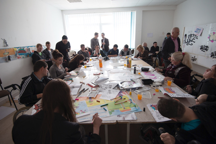 Some of the participants sketching and drawing graffiti around a table. Photo: Charlotta Boucht