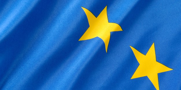 Two yellow stars against a blue background in the EU logo. Photo